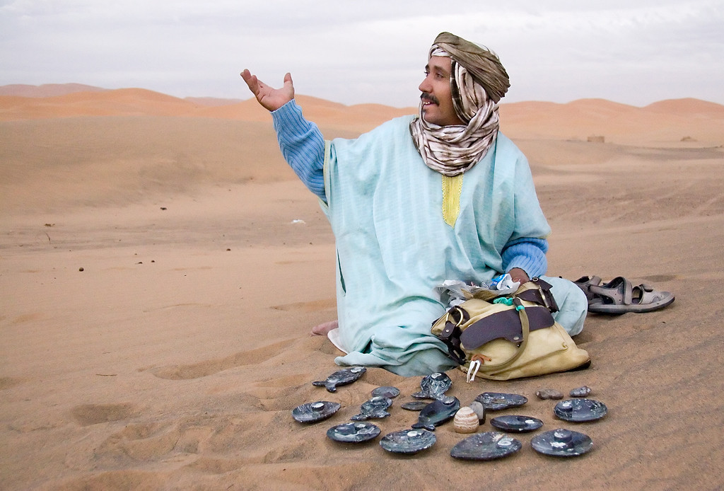 Selling wares in Sahara Desert<br /> <br /> In the morning light in the Sahara, a craftsman displays his wares in anticipation of sales.