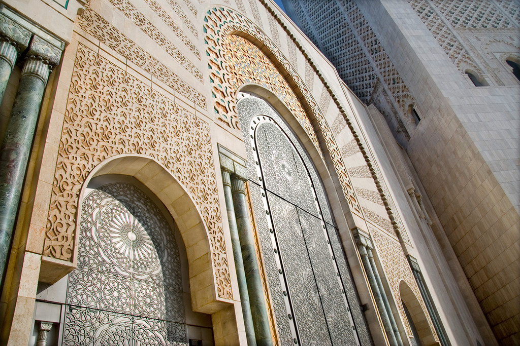 Mosque of Hassan II, Casablanca<br /> <br /> This mosque is the second largest religious building in the world, after the mosque at Mecca.  The fountain arches are decorated with zellij tilework and framed with marble arches and columns.