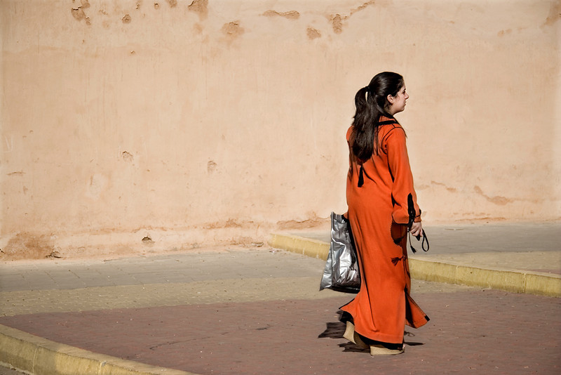 Woman in Medina, Meknès<br /> <br /> The traditional dress for Moroccan women is the djelaba, commonly fashioned in bright colours, and distinguished from the garment worn by men by colour and style.
