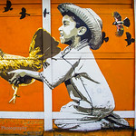 Boy with Chicken:  The Murals of Guelaguetza Restaurant