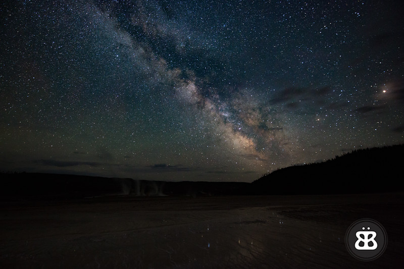 The Milky Way and it's reflection in the Grand Prismatic Spring at Midway Geyser Basin in Yellowstone National Park.