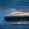 The sun sets behind Clepsydra Geyser.