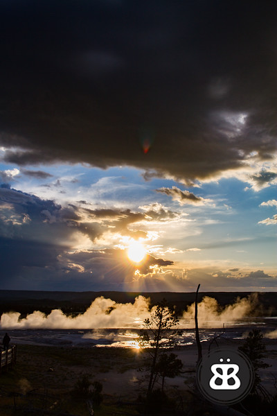 The setting sun highlights the steam rising from the geysers of the Fountain Paint Pot Trail.
