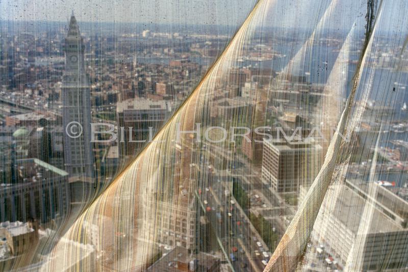 Construction curtain atop International Place Boston