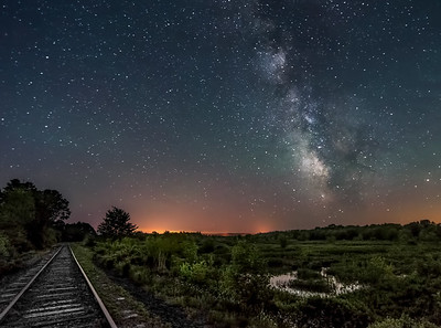 The Milky Way makes for a dramatic background next to the train tracks near Unity Pond, Maine.