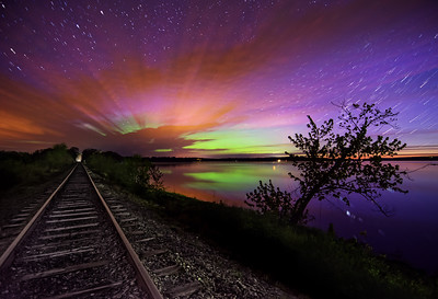 Aurora At Unity Pond #2 - 15 frames (hence the star trails) captured around 3:40 AM from a time lapse that I set up on the train tracks next to Unity Pond, Maine - you can see the sunrise twilight starting to brighten the right hand side of the frame. Photographed May 18, 2013.
