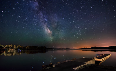 The Milky Way rises over the public boat landing area at China Lake, Maine. Note the  green airglow and the star reflections in the water. Photographed June 4, 2013 @ 1:54 AM.