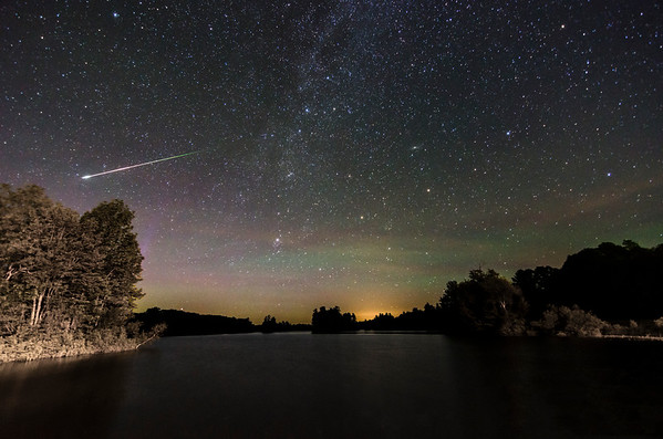 The Milky Way, some green airglow, a hint of purple Aurora Borealis & a fireball meteor shooting through the sky at Branch Pond in Palermo, Maine. Photographed June 10, 2013.