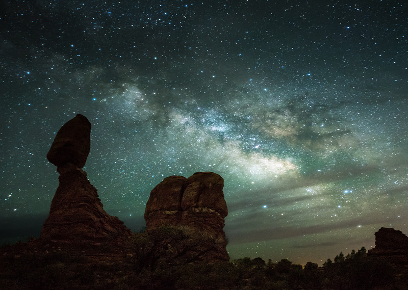 The Milky Way makes a dramatic background for the iconic Balanced Rock area in Arches National Park, Utah.