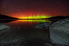 The awe-inspiring green and red hues of the Northern Lights spiked and swirled on the horizon while I was photographing the night sky next to Mt. Kineo at Moosehead Lake - October 10, 2013.