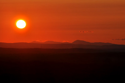 A stunningly red sunset from Mo's Mountain in Maine near Palermo. As the story goes, Mo asked his family to be buried standing up and facing this view so he could continue watching sunsets like this after his death.