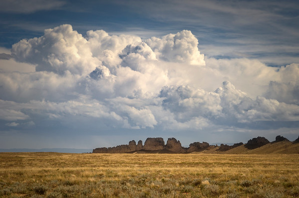 Storm clouds brewing over the Dragons Back at Shiprock, New Mexico.