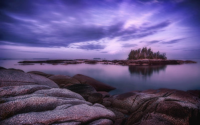 The sunrise blue hour makes a dramatic appearance in the cove near Sand Beach in Stonington, Maine. Photographed July 6, 2013 @ 4:04 AM.