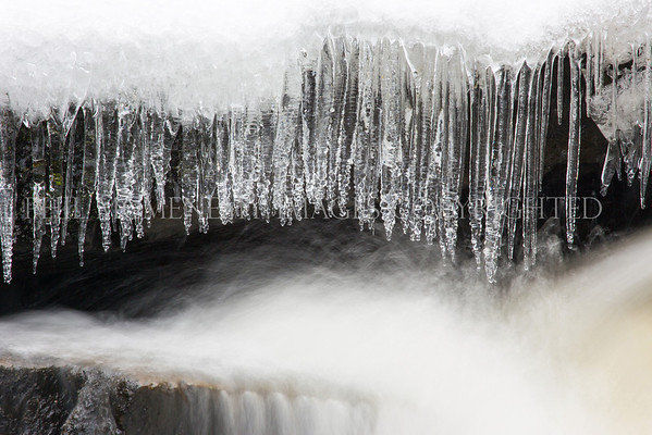 Sculpted<br /> <br /> Icicles, sculpted to perfection, contrasted well by the fluidity of the ice cold water flowing beneath.