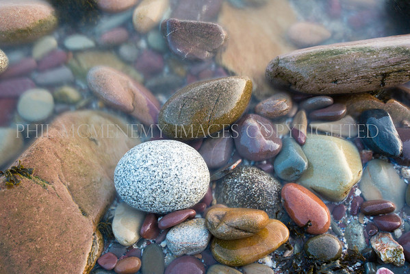Stones, Pebbles and Sea.<br /> <br /> An ebbing tide and an array of textures, shapes and form.
