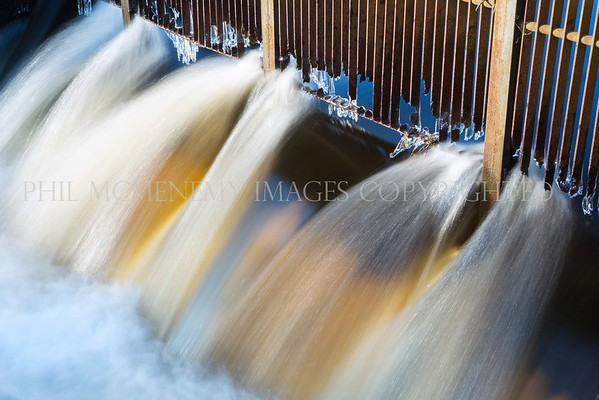 Iron Flow<br /> <br /> i love a contrast, you know that - you know me but this was just special. Very early morning light spills across the cold cold scene  - I love the form of the water against the strength of the iron. Mmmmmmmmm!
