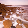 Surf & Boulders<br /> <br /> A lapping tide and sea-rounded boulders converse as they do twice a day.