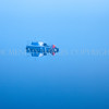 Blue Boat<br /> <br /> Early winter and the mist is gently lifting to reveal a lone boat on a glass-like loch.