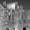 One Cloud<br /> <br /> Making the shot the softness and incongruity of the cloud against the ego of the castle