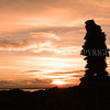 Cairn and Sunset<br /> <br /> Cairn on a tiny isthmus in Wigtown Bay at sunset