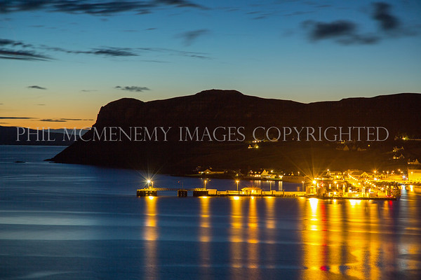 Uig Night<br /> <br /> The brash beacon of the tiny Uig ferryport light up the dusk.