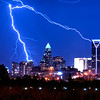 lightning strikes over charlotte skyline