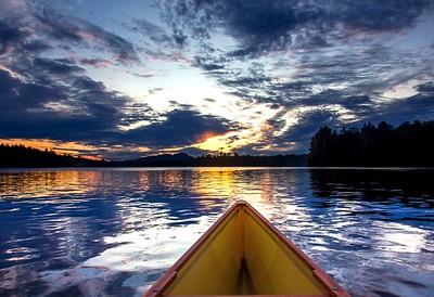 wild canoe sunset