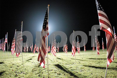 Spencer Tulis A temporary Field of Honor and its over 200 American flags stand under the glow of two portable lights at the Seneca lake State Park making the site accessible all night long the past few days for those interested in viewing in the silence of nighttime. It is organized by the non-profit Trauma Response assistance for Children Team. The field will be dismantled today.