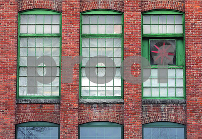 Spencer Tulis/Finger Lakes Times A red fan sits in one of the large windows along the north wall of Evans Chemetics in Waterloo. The simple and graphic nature of the image often draws me to take these kinds of photographs.