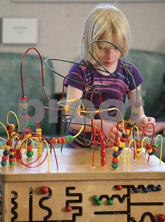Spencer Tulis/Finger Lakes Times Sarah Milke, 5, of Lyons keeps herself busy recently in the waiting room at Finger Lakes Medical Associates in Geneva.