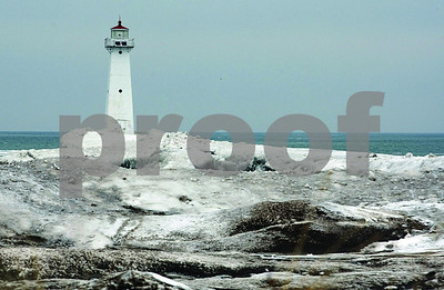 Spencer Tulis / Finger Lakes Times Snow and ice builds up around the jetty that is home to the Sodus Point Lighthouse and the artic cold has been a constant visitor to the area this winter.