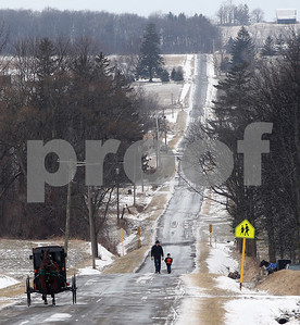 Spencer Tulis/Finger Lakes Times It was the end of the school day at a Mennonite school in the town of Benton Friday as a father walks with his son along a country road.