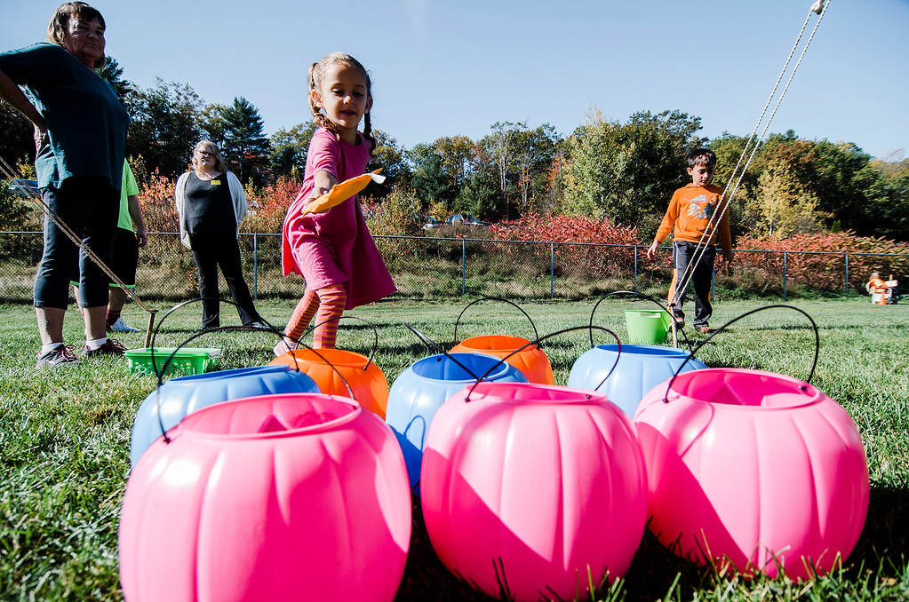 . Lilah Archambeault, 5, plays a game during the Finish Lyme Love your Neighbor Road Race on Saturday, October 21, 2017. The race was to sponsor medical treatment for Brittany Brassard, a 29-year-old Ashburnham resident who is battling Chronic Lyme Disease. SENTINEL & ENTERPRISE / Ashley Green