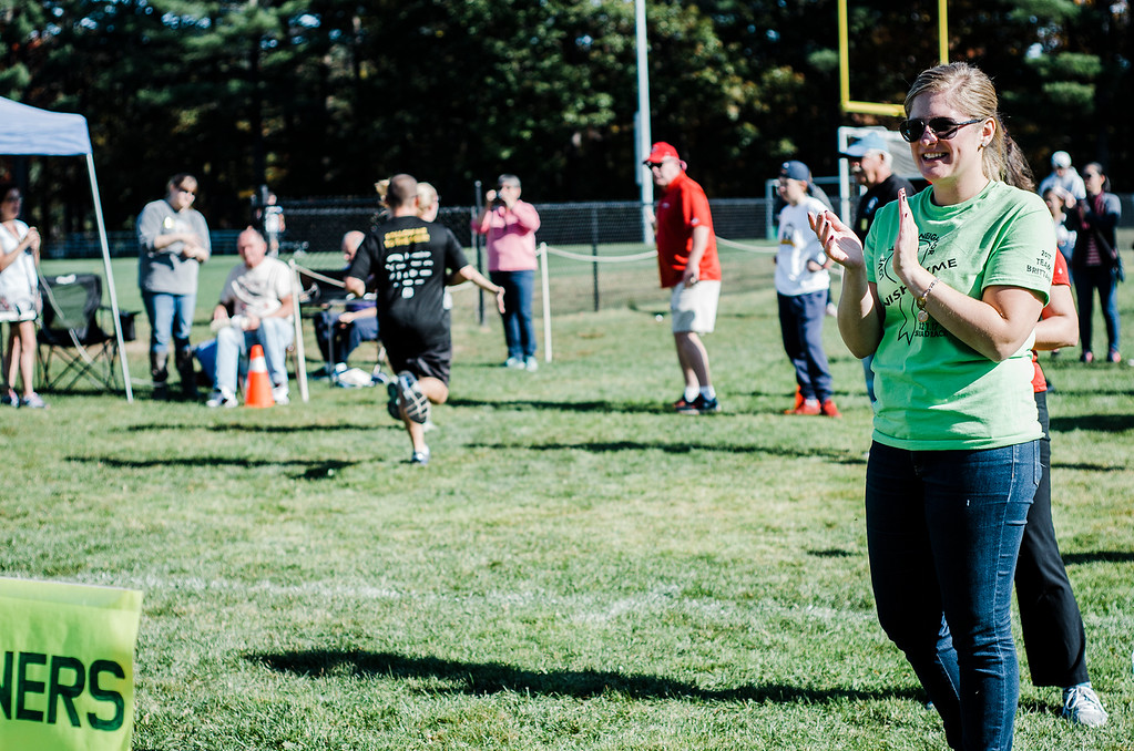 . Brittany Brassard cheers on runners during the Finish Lyme Love your Neighbor Road Race on Saturday, October 21, 2017. The race was to sponsor medical treatment for Brittany Brassard, a 29-year-old Ashburnham resident who is battling Chronic Lyme Disease. SENTINEL & ENTERPRISE / Ashley Green