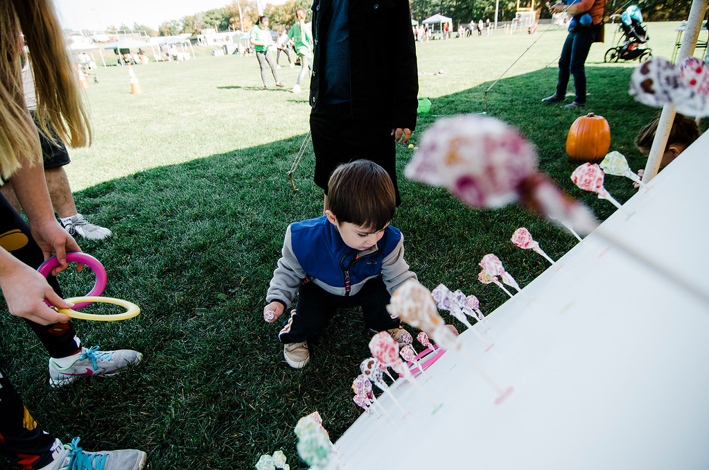 . Andrew Correa, 2, plays a ring toss game during the Finish Lyme Love your Neighbor Road Race on Saturday, October 21, 2017. The race was to sponsor medical treatment for Brittany Brassard, a 29-year-old Ashburnham resident who is battling Chronic Lyme Disease. SENTINEL & ENTERPRISE / Ashley Green