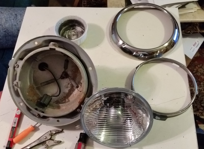 "Just got these Hella (made in Germany) Halogen Vision Plus with 60/55 watt lamps - European beam technology but DOT approved. Cleaned out the dirt dauber nests, scrubbed down the buckets, polished the small hold down bracket, new socket assembly and new stainless ring and gaskets. The glass front isn't as curved as ""stock"" lamps, but that's ok. They aren't ""flat""."