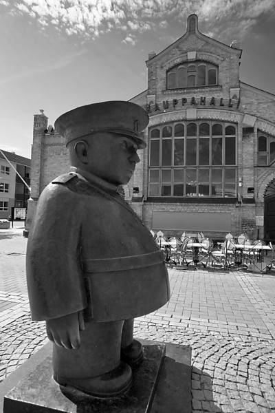 Monday, July 5, 2010<br /> <br /> Tori Poliisi, Oulu Kauppatori<br /> <br /> The portly Market Policeman stands diligently at the entrance of the kauppatori, casting a watchful eye over all entering and departing. I'm not aware of any meaning or significance to this statue, or if it represents an actual person - haven't had time to research it yet. But judging from his substantial girth, I suspect he spends his off time at Bisketti's, sampling the large variety of pulla and pastry. I think we'd get along just fine, he and I.