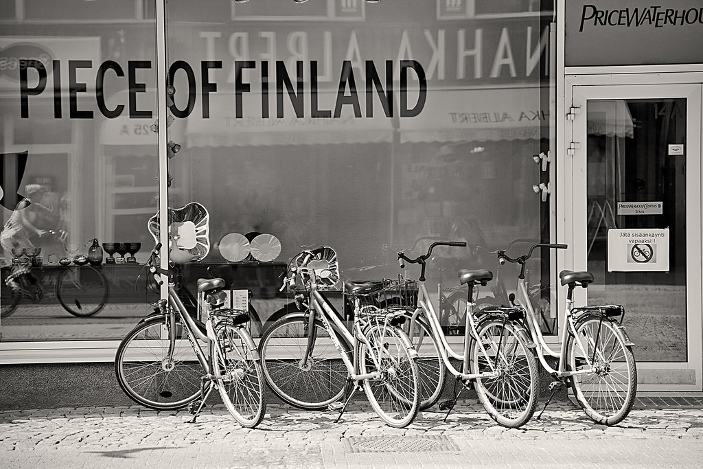 Monday, July 5, 2010<br /> <br /> Piece of Finland, Oulu Storefront<br /> <br /> We actually left Oulu today and arrived in Rovaniemi on the arctic circle around 3PM. Haven't had a chance to explore here much, (too busy eating sauteed reindeer and lingonberry at the wonderful hotel ravintola) but the train ride provided some down time to process images from Oulu. So today I am posting a black & white series on the city of Oulu.