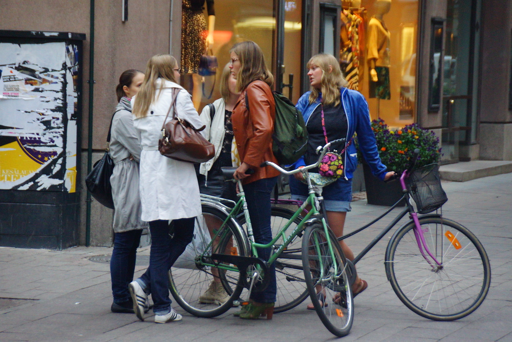 A group of girl friends dressed up nicely meeting up in downtown Helsinki, Finland