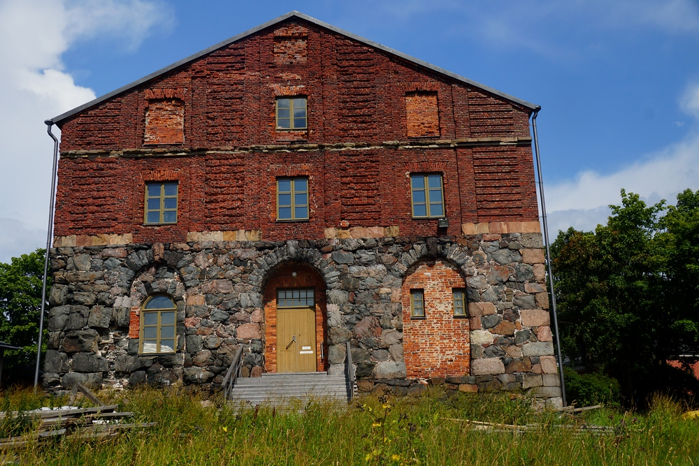 A rustic stone and brick building near the outer edges of Suomenlinna