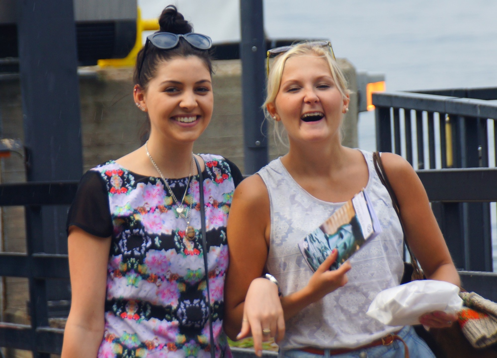 Two ladies sharing a laugh while visiting Suomenlinna, Finland
