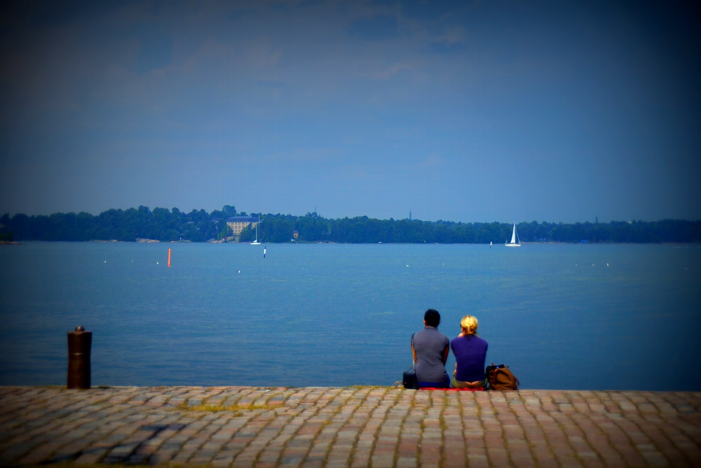 A couple enjoying looking out over the water