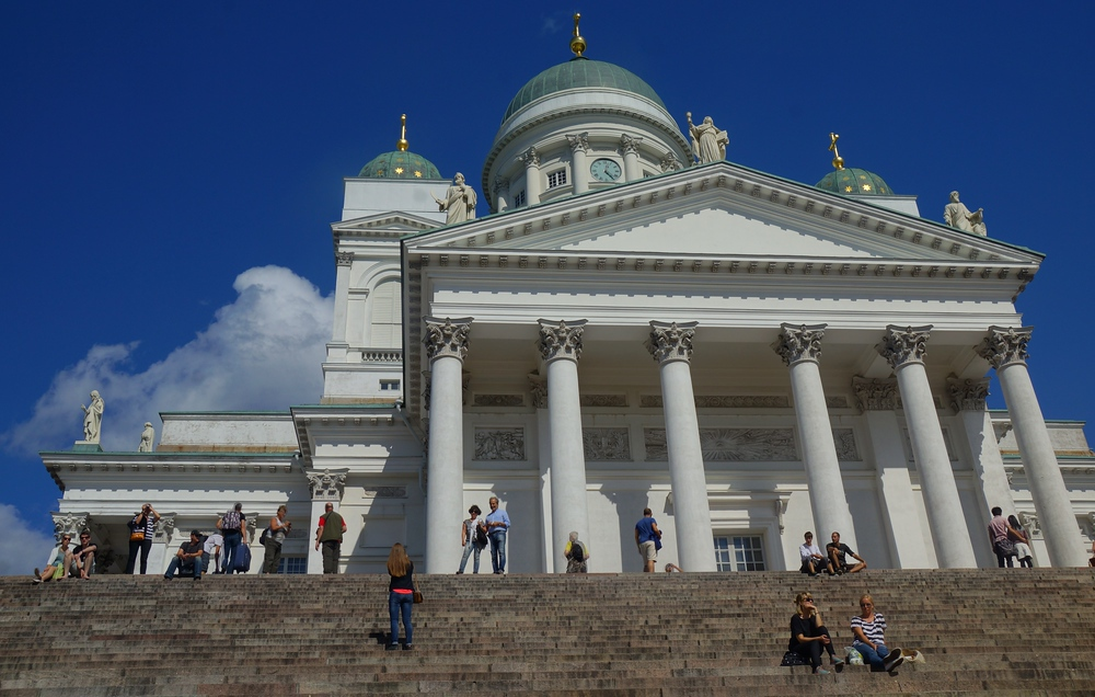 People standing on the steps and admiring the views of Helsinki, Finland from Helsinki, Cathedral