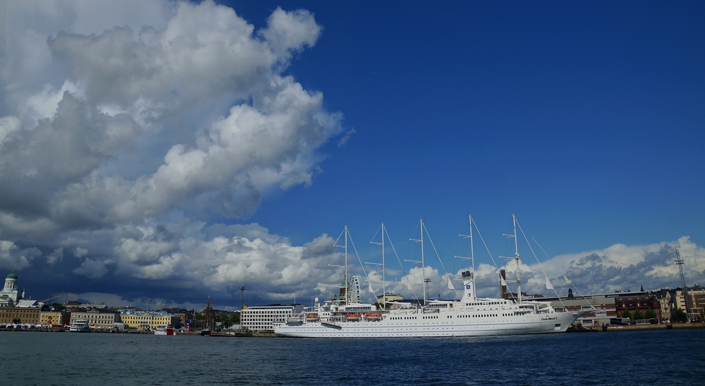 A perspective shot of an enormous cruise liner docked in Helsinki on a gorgeous summer afternoon in Finland