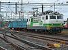 Sr1 3055 brings a train of empty wagons through Riihimaki on 10 August 2012