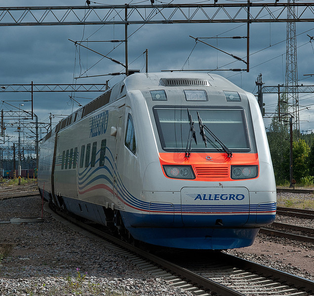 The rear of Pendolino set 53 for the St. Petersburg services displays the Alstom symbol below the window as it departs from Kouvola on 10 August 2012