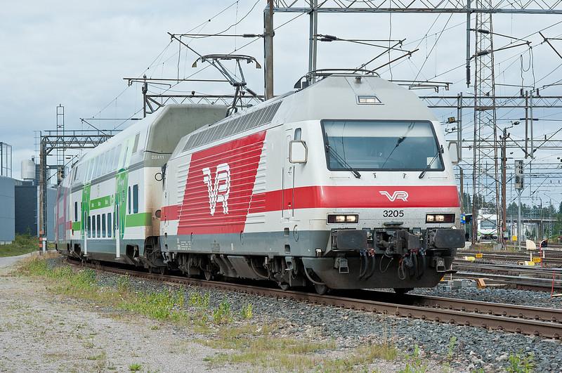 A Helsinki service leaves Riihimaki on 10 August 2012 behind Sr2 3205