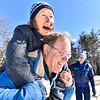 Mike Potsaid carries Lorna Sulin who is not his wife during a wife carrying race held at Saima Park Finnish Center in Fitchburg on Saturday Feb. 4, 2017. (Sentinel & Enterprise photo/Jeff Porter)