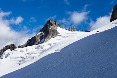Climbers cross glacier towards Mount Underwood, Darran Mountains, Fiordland National Park