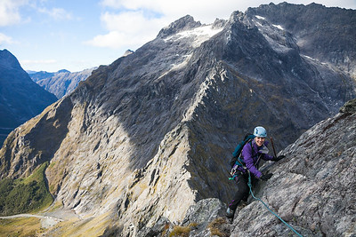Female climber on the Mcpherson - Talbot Traverse, Fiordland National Park